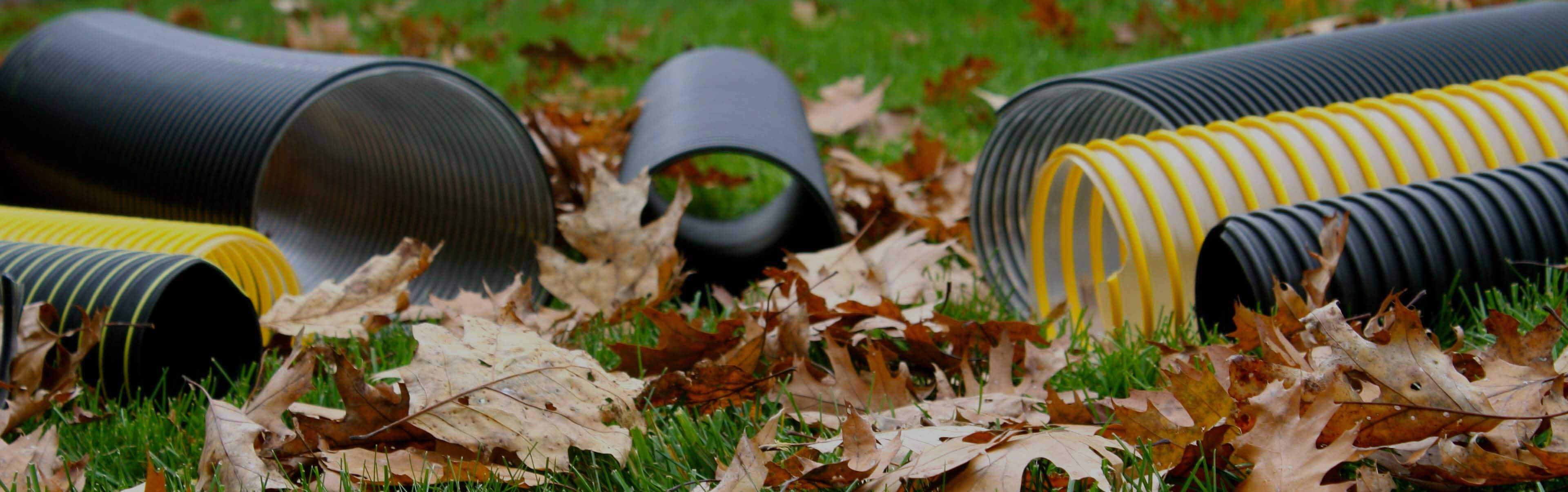 photo of leaf vacuum hose with leaves