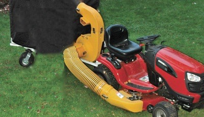 photo of a Cyclone Rake Lawn and Leaf Vac Hose on lawn tractor